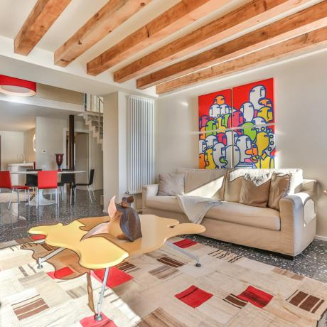 The sunny and stylish living room at Ca' del Redentore apartment