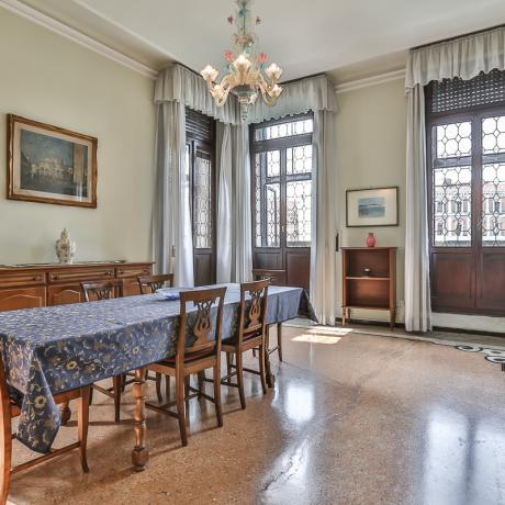 The classic dining room at Canal Grande apartment overlooking Rialto Bridge