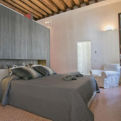 The comfortable master bedroom at Santa Giustina apartment