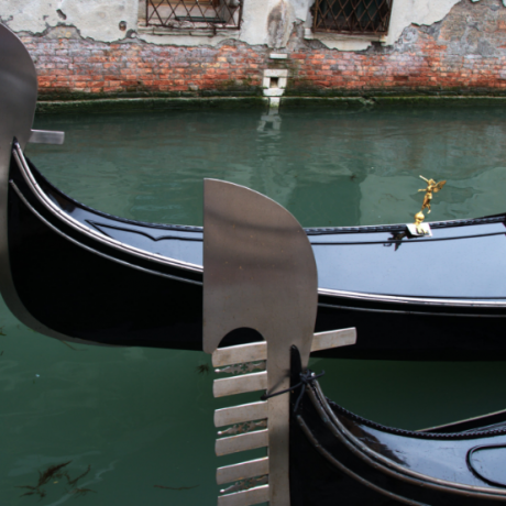 The charming gondolas along the canals in Venice